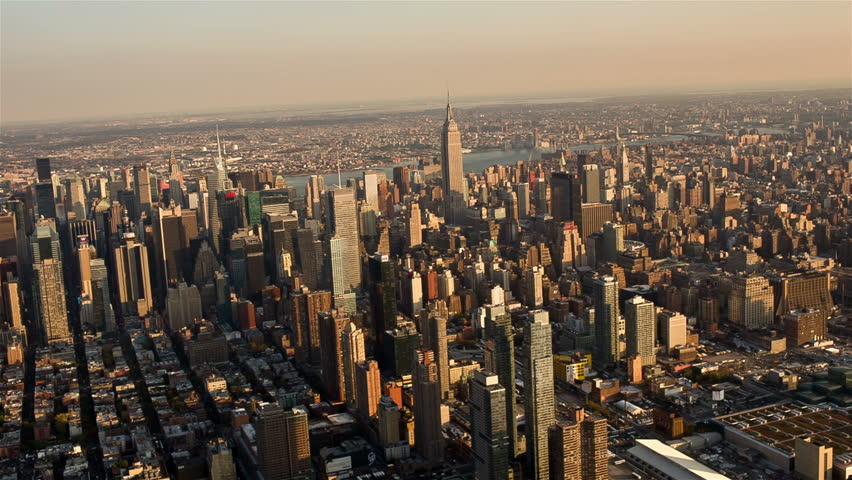 NEW YORK - OCTOBER 29: aerial of Manhattan on October 29, 2013 in New York. Manhattan is the geographically smallest yet most densely populated of all five New York City boroughs.  | Shutterstock HD Video #4995827