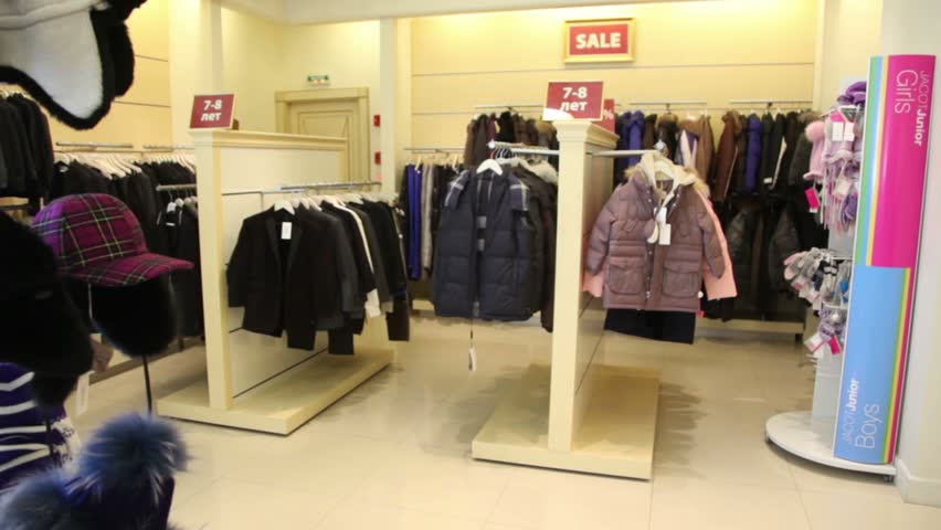 children clothing store with sale warm coats and hats - HD stock video clip