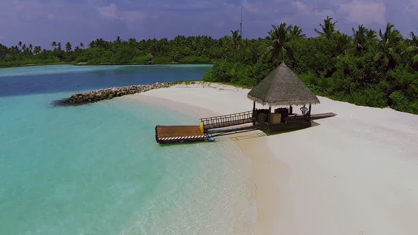 Maldives beach panorama with the house. aerial video