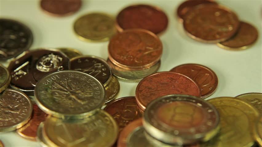 Coins dropping. Close up shot.