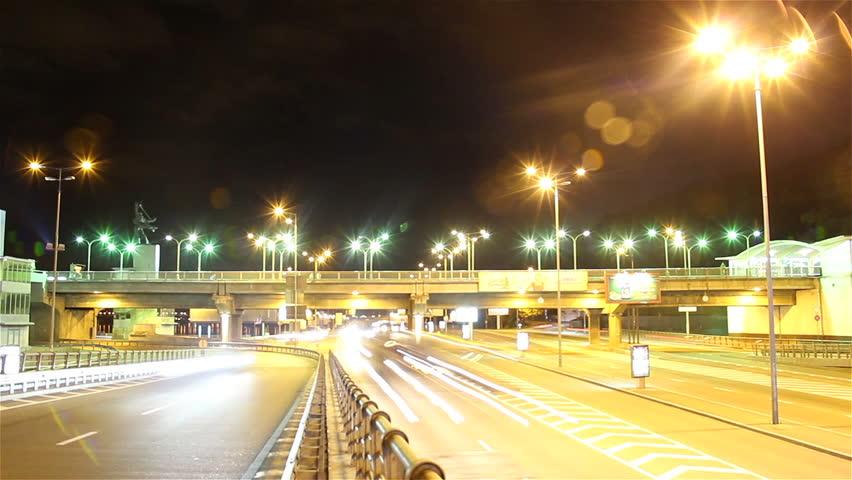 Train bridge night city timelapse, cars drive, lights shine, red