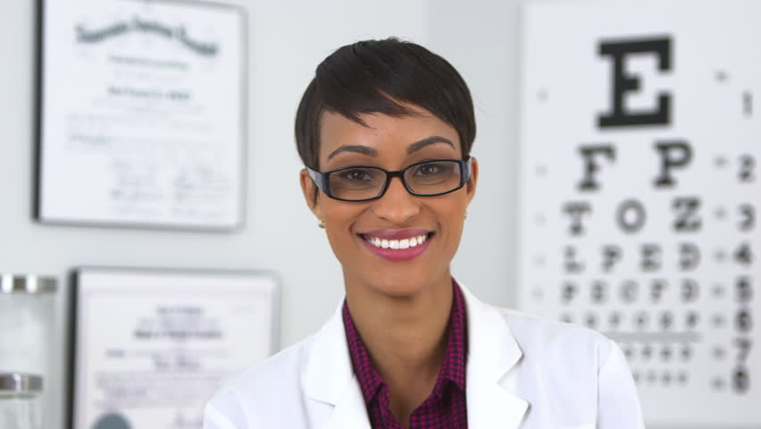 Happy optometrist looking at camera - HD stock video clip