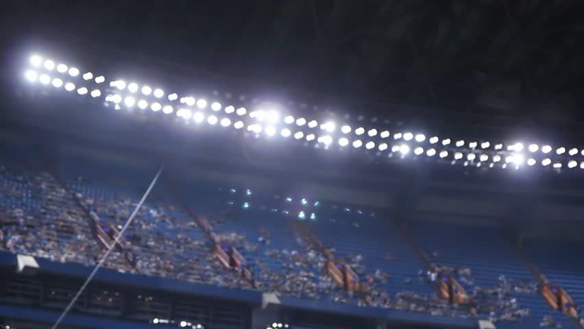 Floodlights at sports stadium. Defocused.