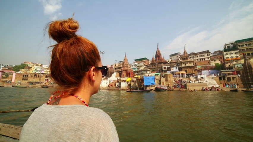 Caucasian tourist girl, indian boat, varanasi ganges river, india