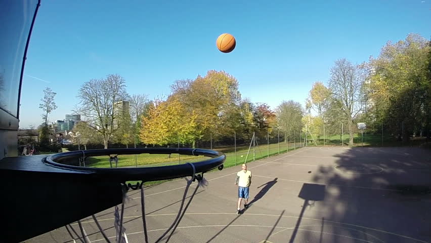 Basketball player shooting a 3 point jump shot in slow motion and scoring - HD stock footage clip