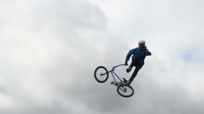 Failed attempt for jumping bicycle rider, falls down slow motion