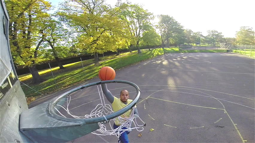 Basketball player slam dunking the ball in slow motion - HD stock video clip