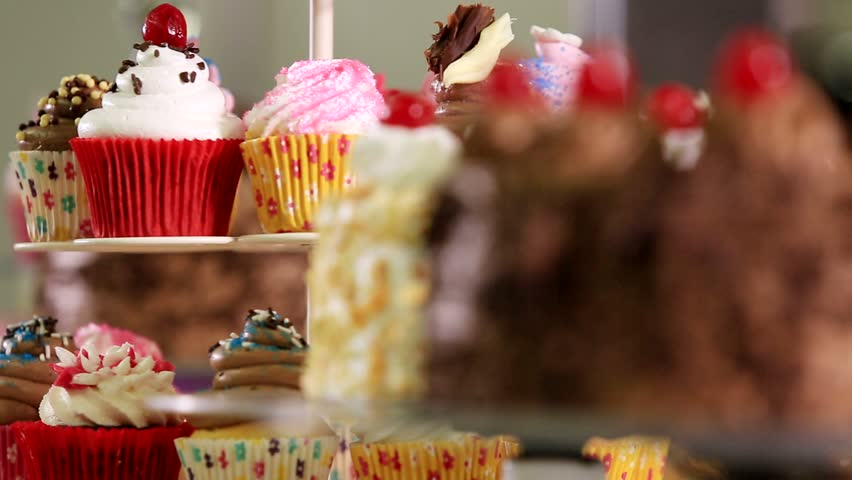 Closeup of chocolate cake and cup cakes #5089976