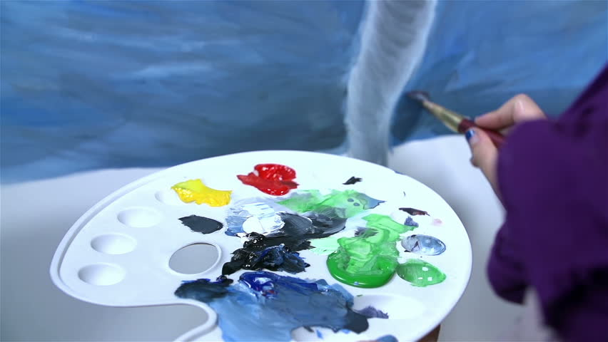Detail on palette while artist drawing artwork - HD stock video clip
