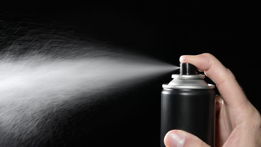 A man depresses the trigger on an aerosol spray can. | Shutterstock HD Video #5091605