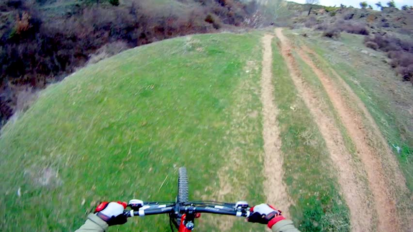 Man riding Mountain Bike on Extreme terrain POV