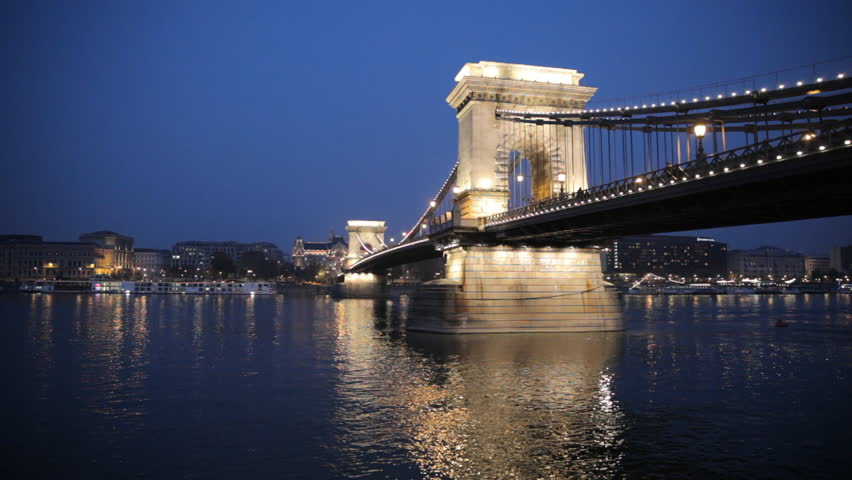 The Szechenyi Chain Bridge In Budapest Hungary Connecting The Two Cities Of Buda And Pest Across The River Danube At Night Time
