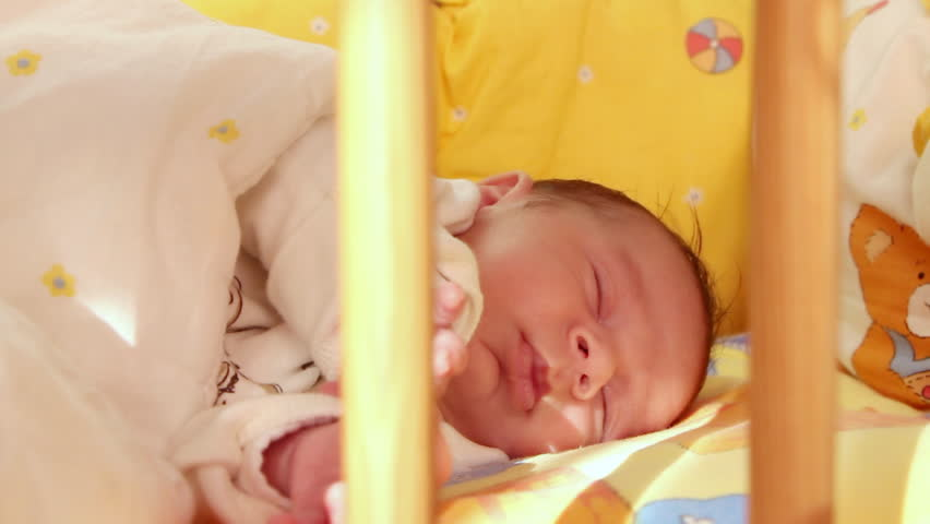 Mother kissing her sleeping baby - HD stock video clip
