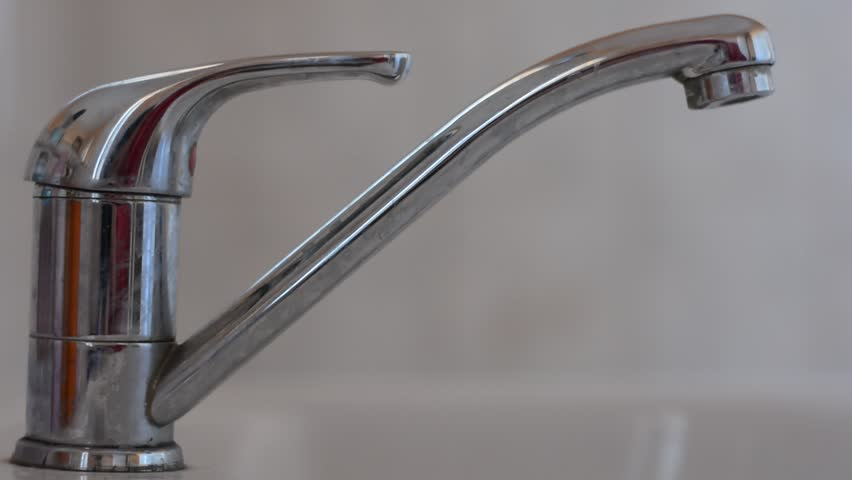 tapping water from kitchen faucet open stock