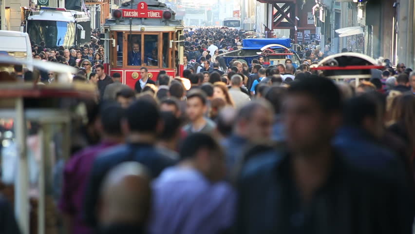ISTANBUL - 09 November 2013 famous istiklal street Istanbul Turkey, tram and crowded people at istiklal avenue