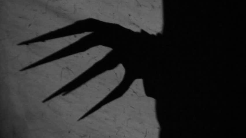 Spooky shadows on the wall. Nr.2. | Shutterstock HD Video #5165810