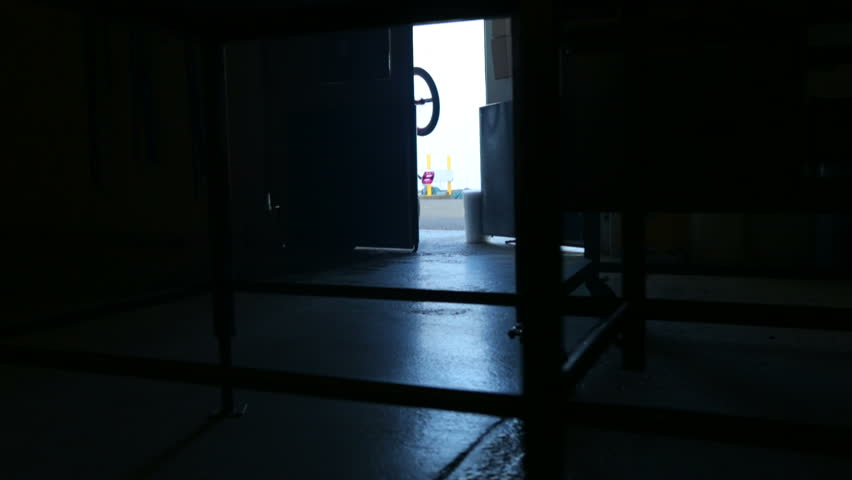 BMX rider going into dark warehouse - HD stock video clip