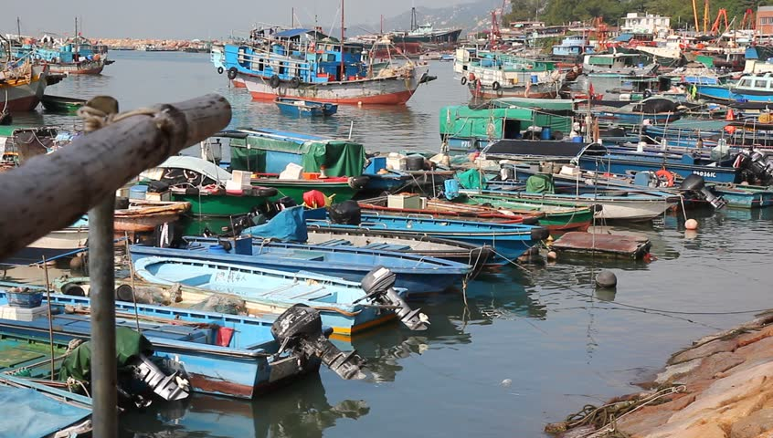 HONG KONG - CIRCA 2013: The island of Cheung Chau, a colorful fishing village, a short ferry ride from downtown Hong Kong. Fishing village boats. | Shutterstock HD Video #5180606