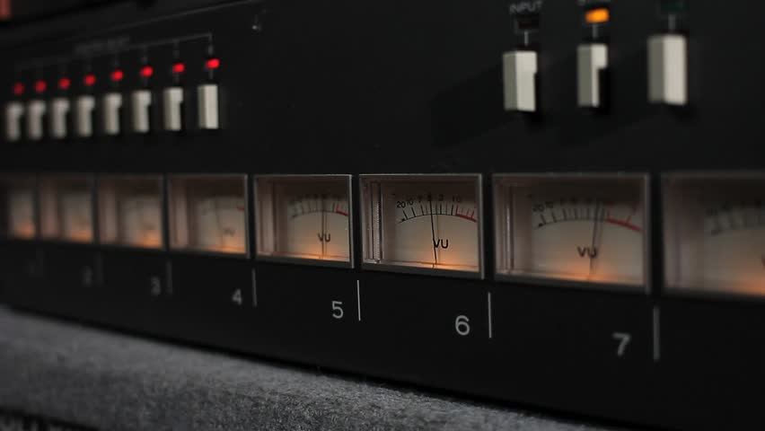 A Raking Shot of Multiple VU Meters.