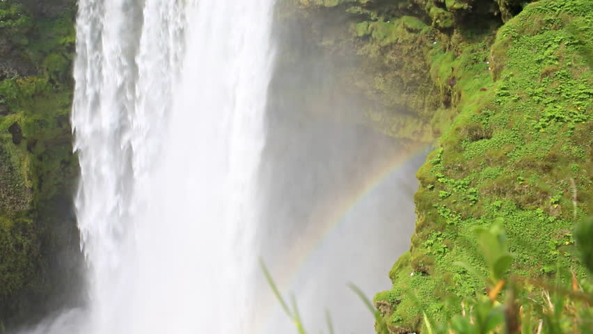 Closeup of skogafoss waterfall and rainbow on the South of Iceland near the town Skogar
