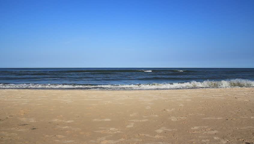 Static scene. Blue sky and sand. Sea water, waves. Perfect scene for background use. - HD stock footage clip