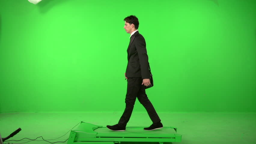 Business man walking on a green screen backround | Shutterstock HD Video #5226200