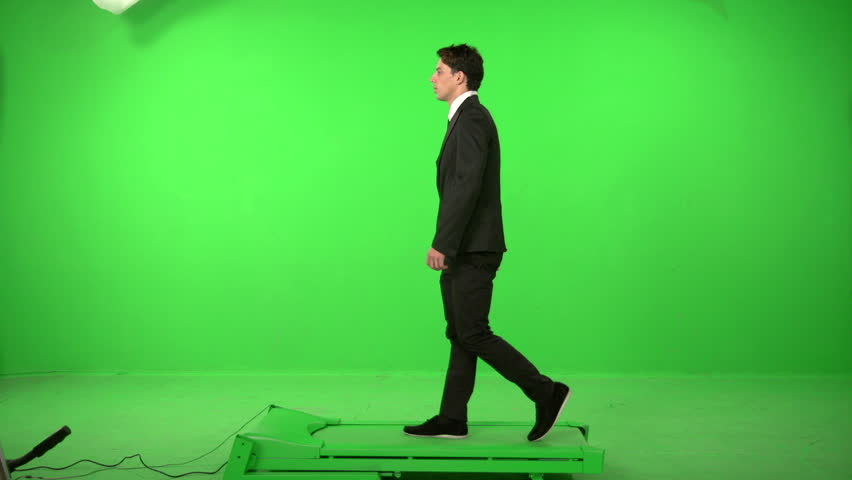 Business man walking on a green screen backround | Shutterstock HD Video #5226299