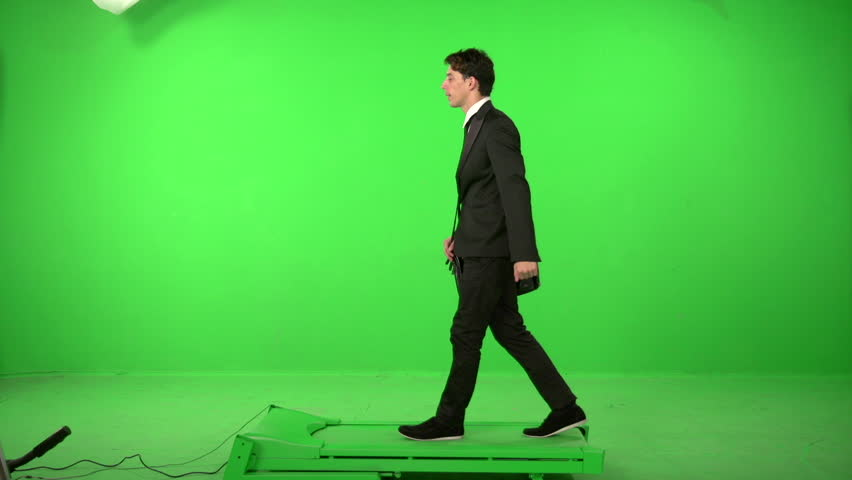 Business man walking on a green screen backround | Shutterstock HD Video #5226335