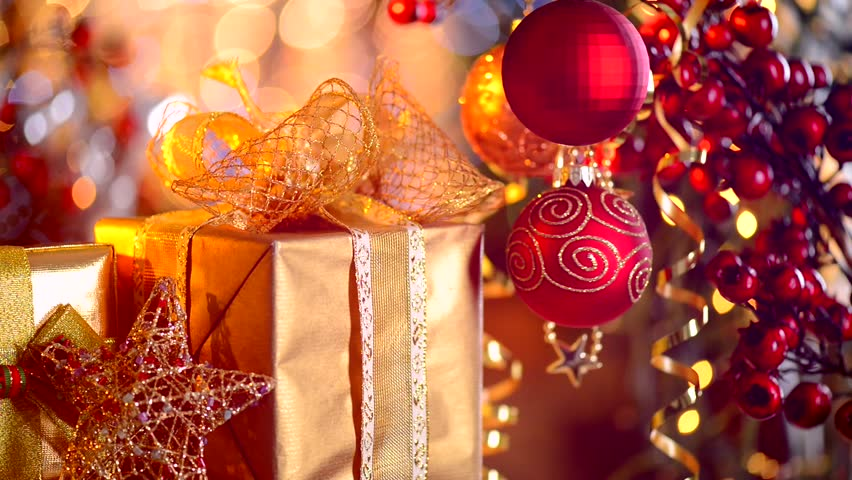 Christmas and New Year Gifts and Decoration. Abstract Blurred Bokeh Background. Gift Box and Baubles close up. HD Video Footage - HD stock footage clip