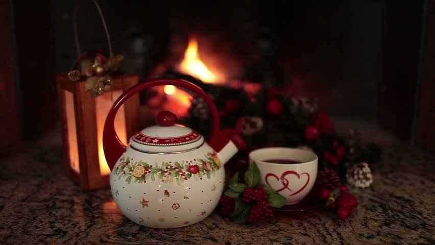 Tea time during the winter holidays in front of the fireplace.