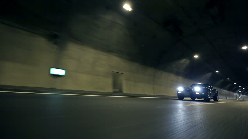 Low angle shot of car driving by - HD stock footage clip