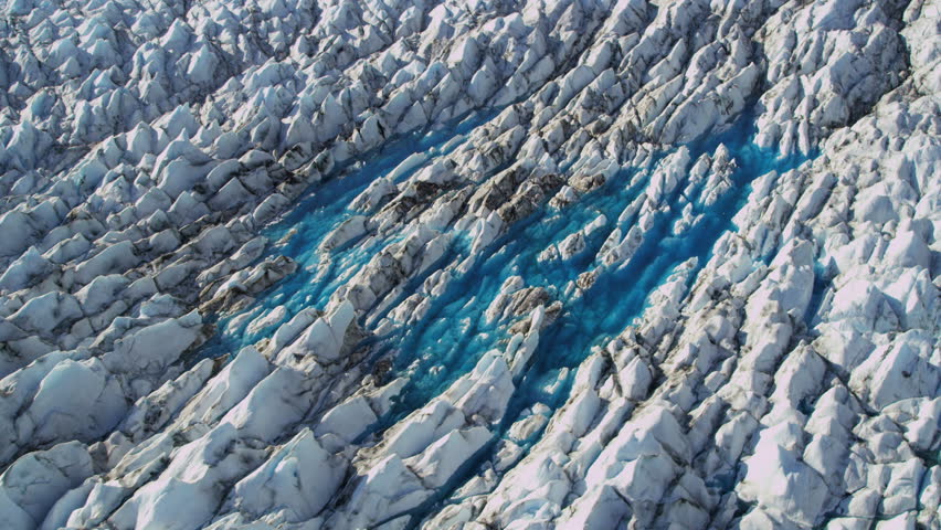 Aerial view of Ice Glacier flows melting Global warming Arctic Region, Northern Hemisphere shot on RED EPIC. 4K, UHD, Ultra HD, resolution