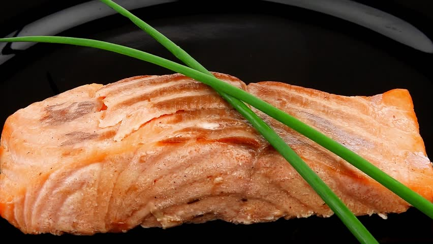 healthy fish cuisine : baked pink salmon steaks with green onion on black dish 1920x1080 intro motion slow hidef hd