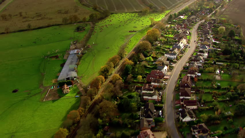 Aerial view over houses in the English countryside