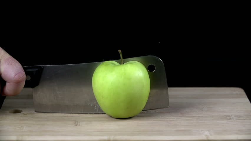 Green apple chopped up in half with a cleaver