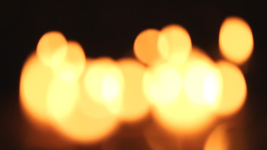Candles light, black background. - HD stock footage clip