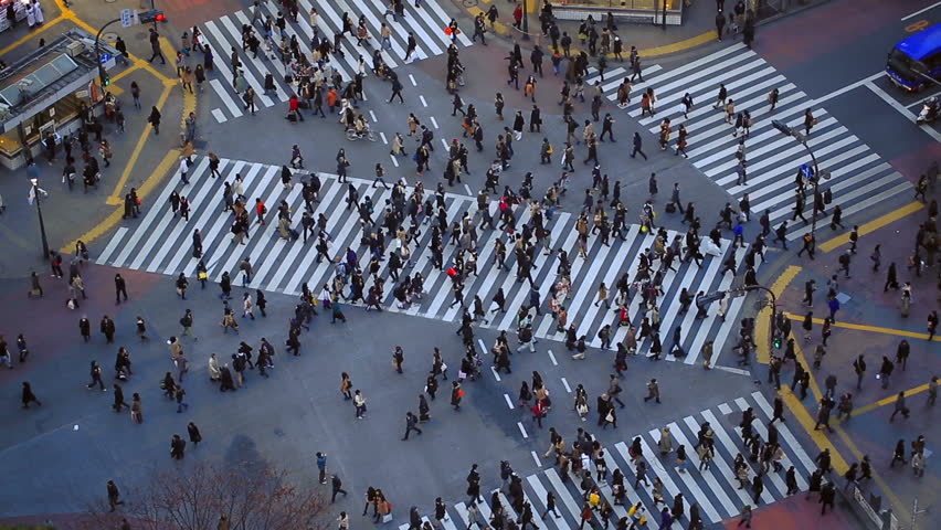 City pedestrian traffic of people crossing the famous Shibuya intersection in Tokyo. | Shutterstock HD Video #5289929