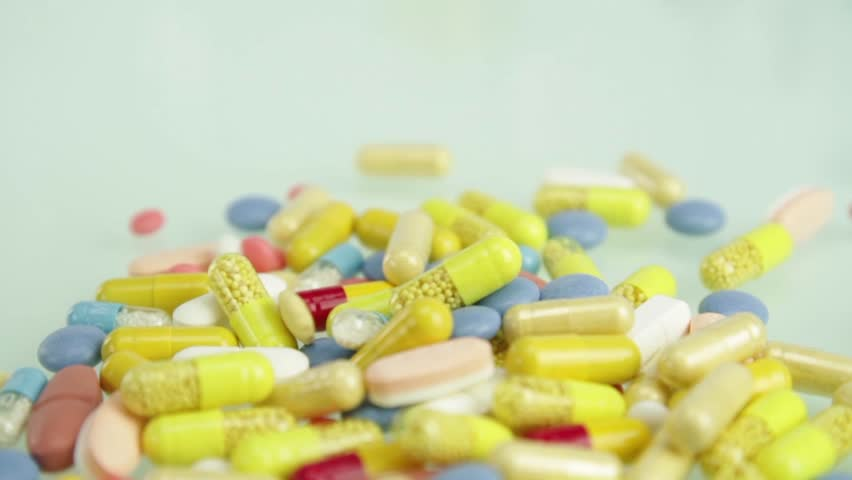 Colorful Medicine Pills Falling Pharmacy Concept