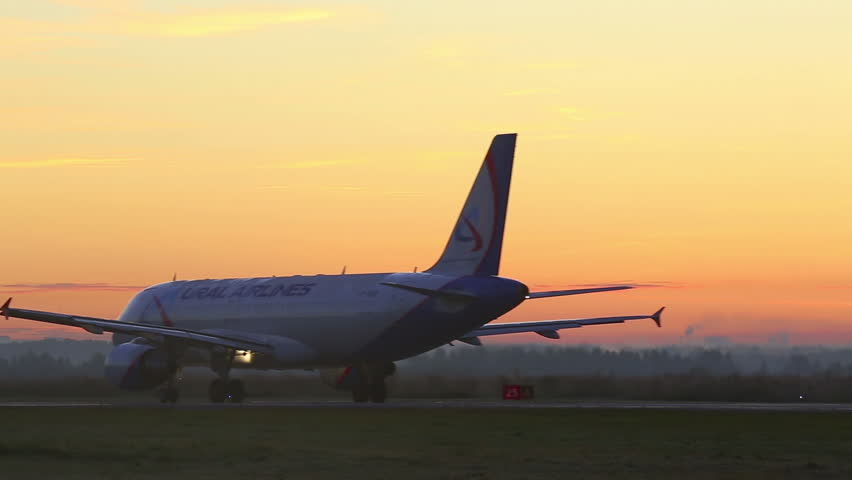 NOVOSIBIRSK, RUSSIA - SEPTEMBER 13, 2013:  Airbus A-320 jet airliner taxiing to the runway at dawn. Spotting at airport Tolmachevo, Sep.13, 2013, Novosibirsk, Russia.  - HD stock video clip