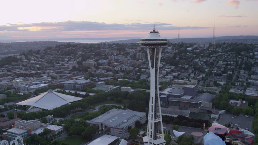 Seattle - July 2013: Aerial sunset view Space Needle Observation Tower Seattle residential suburbs Elliot Bay, Puget Sound, Washington, Pacific Northwest, USA, RED EPIC, 4K, UHD, Ultra HD resolution - 4K stock video clip