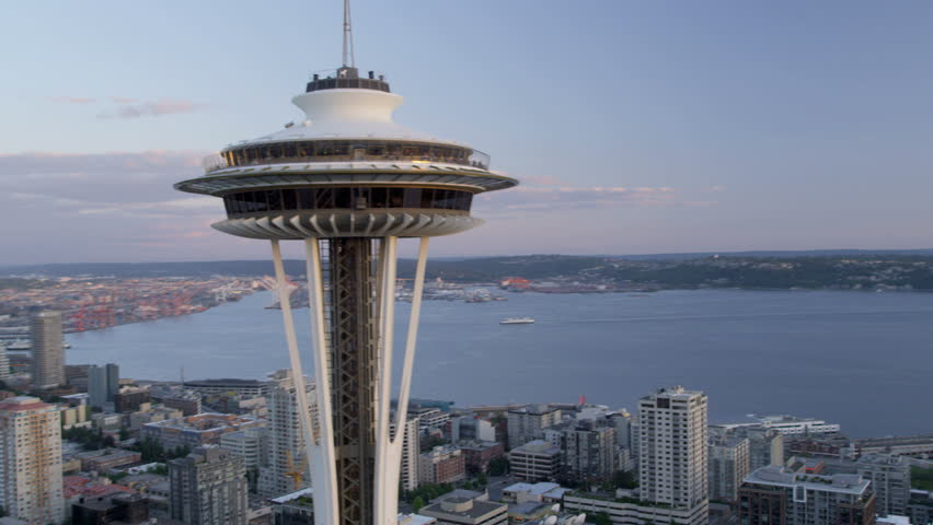 Seattle - July 2013: Aerial close up view at sunset Seattle Space Needle Elliot Bay, Puget Sound, Washington State, Pacific Northwest, USA, RED EPIC, 4K, UHD, Ultra HD resolution - 4K stock footage clip