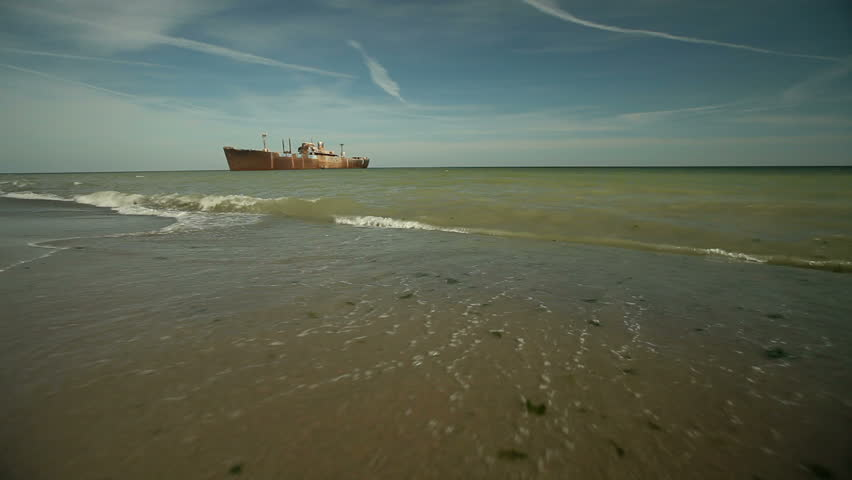 Ship wreckage and beach. - HD stock video clip