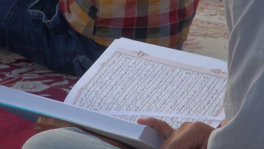 SHIRAZ, IRAN - 27 OCTOBER 2013: Reading through the Quran, during a public lesson in Shiraz, Iran - HD stock video clip