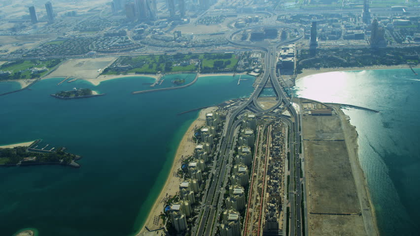 Aerial view of Causeway to Palm Jumeirah with Media City and Knowledge Village, Dubai, UAE, RED EPIC, 4K, UHD, Ultra HD resolution | Shutterstock HD Video #5313491