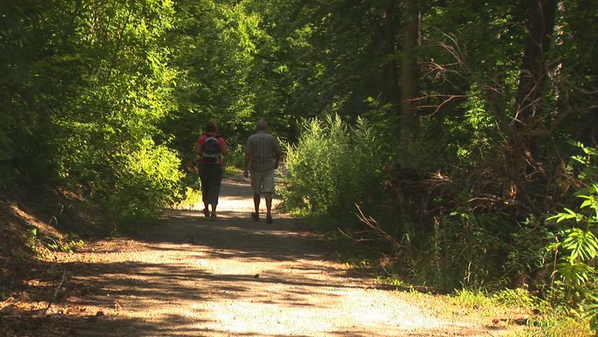Couple Walking Down a Path