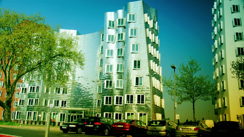 DUSSELDORF, GERMANY, May 8: Dusseldorf Harbor is home to some spectacular postmodern architecture, with contemporary status symbols signifying corporate success: Frank Gehry.,May 8, 2013,time lapse,4k color graded - 4K stock footage clip
