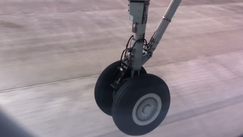 The airplane takes off. aerial view. wheels contract.