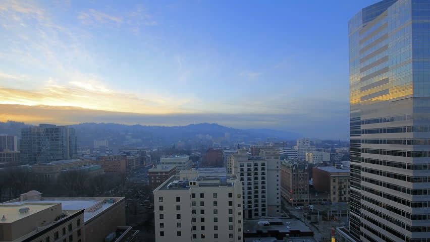 Portland Oregon Downtown Cityscape at Sunset with Moving Clouds and Blue Sky Time Lapse 1920x1080 - HD stock video clip