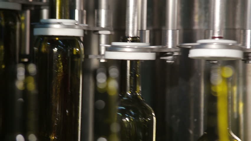 Empty Wine Bottles Picked Up by the Grippers - HD stock video clip