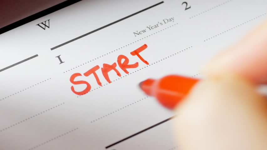Writing Start Diet on calendar on New Year's Day | Shutterstock HD Video #5357663